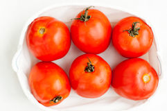 Fresh ripe red tomatoes in the box Stock Images