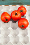 Fresh ripe red tomatoes in the box Royalty Free Stock Photos