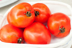 Fresh ripe red tomatoes in the box Royalty Free Stock Images