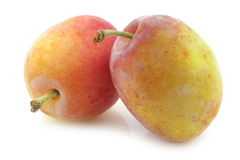 Fresh ripe red and yellow plums Stock Images