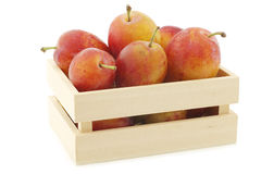 Fresh ripe red and yellow plums in a wooden box Royalty Free Stock Photography