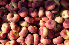Fresh ripe saturn peaches in a market. Stock Images