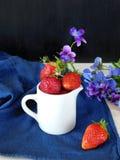 Fresh ripe strawberries in a ceramic jug Stock Images