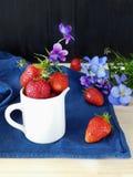Fresh ripe strawberries in a ceramic jug Stock Image