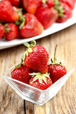 Fresh ripe strawberries in glass bowl Stock Images