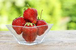 Fresh ripe strawberries in glass bowl Royalty Free Stock Image