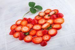 Fresh ripe strawberries in heart shape on white wood plate kitchen table. Can be used as background Stock Image