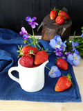 Fresh ripe strawberries in a jug Royalty Free Stock Image