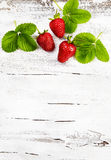 Fresh ripe  strawberries on an old wooden table Stock Images