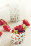 Fresh ripe strawberries on a paper case Stock Photography