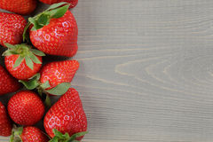 Fresh ripe strawberries on rustic wood table Stock Images
