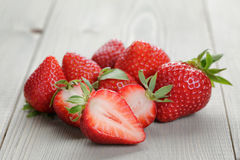 Fresh ripe strawberries on rustic wood table Stock Photo