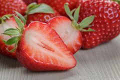 Fresh ripe strawberries on rustic wood table Royalty Free Stock Photos