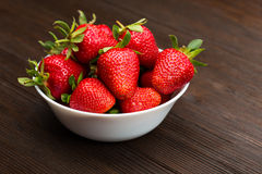 Fresh ripe strawberries in a simple white bowl Royalty Free Stock Image