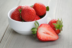 Fresh ripe strawberries in a simple white bowl Royalty Free Stock Photo