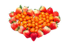 Fresh ripe strawberries and tomatoes heart shaped Stock Images