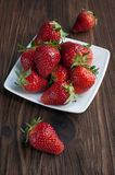 Fresh ripe strawberries in a white plate Royalty Free Stock Image