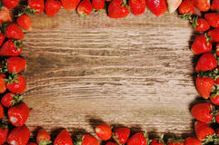 Fresh ripe strawberries on a wooden table. Stock Photo
