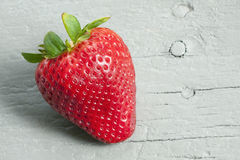 Fresh ripe strawberry. Beautiful red fresh strawberry on old gray wooden table Stock Photo