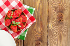 Fresh ripe strawberry in bowl and milk Royalty Free Stock Images