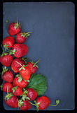 Fresh ripe strawberry on dark background, top view, copy space Stock Photos