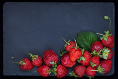 Fresh ripe strawberry on dark background, top view, copy space Royalty Free Stock Photo
