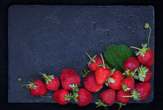 Fresh ripe strawberry on dark background, top view, copy space Stock Photo