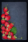 Fresh ripe strawberry on dark background, top view, copy space Royalty Free Stock Images