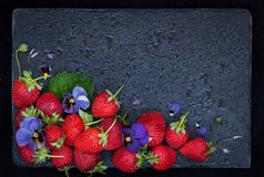 Fresh ripe strawberry on dark background, top view, copy space Stock Photography