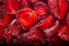 Fresh ripe strawberry in own juice for  summer pie or cake. Top view. Close up royalty free stock photos