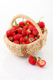Fresh ripe strawberry in a wattled basket. Still-life with a strawberry in a wattled basket royalty free stock images