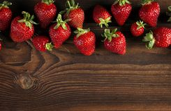 Fresh ripe strawberry on wood Royalty Free Stock Image