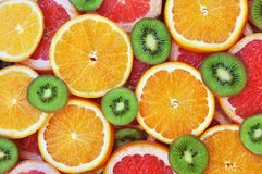 Fresh ripe sweet citrus and kiwi fruits stock image