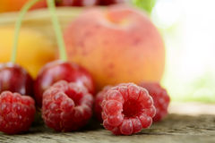 Fresh Ripe Sweet Fruits on the Wooden Table Stock Photos