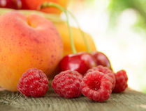 Fresh Ripe Sweet Fruits on the Wooden Table Royalty Free Stock Photos