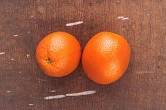 Fresh Ripe Sweet Orange Fruit on Rustic Brown Wood Background Royalty Free Stock Image
