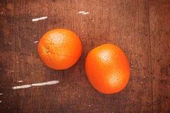 Fresh Ripe Sweet Orange Fruit on Rustic Brown Wood Background Stock Image