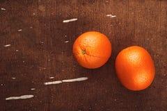 Fresh Ripe Sweet Orange Fruit on Rustic Brown Wood Background Royalty Free Stock Photo
