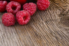 Fresh Ripe Sweet Raspberry on Wooden Background. Fresh Organic Food. Space for Text Stock Images