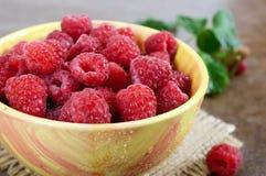 Fresh ripe tasty raspberries in a yellow ceramic bowl. Summer berries Stock Photography