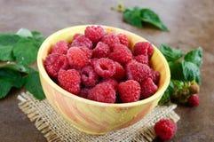 Fresh ripe tasty raspberries in a yellow ceramic bowl. Summer berries Royalty Free Stock Image