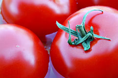 Fresh Ripe Tomatoes. Rich in antioxidants, tomatoes are important in maintaining cardiovascular health as well as protecting the body against some forms of Stock Photo