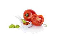 Fresh and ripe tomatoes and red pesto. Royalty Free Stock Photo