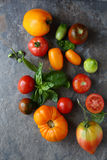 Fresh ripe tomatoes on slate Stock Photo