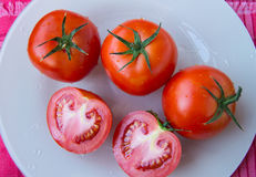 Fresh ripe tomatoes on white dish - top view.  stock image