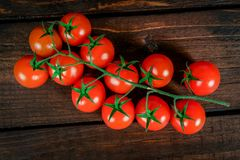 Fresh ripe tomatoes . On a wooden table royalty free stock photos