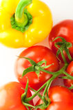 Fresh ripe tomatoes and yellow pepper Royalty Free Stock Photos