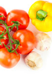 Fresh ripe tomatoes, yellow pepper and garlic Royalty Free Stock Photography