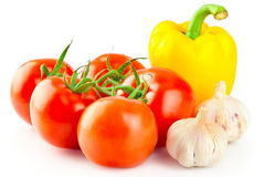 Fresh ripe tomatoes, yellow pepper and garlic Stock Photos