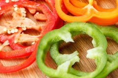Fresh, ripe vegetable, bell pepper on cutting board. Background Stock Photography